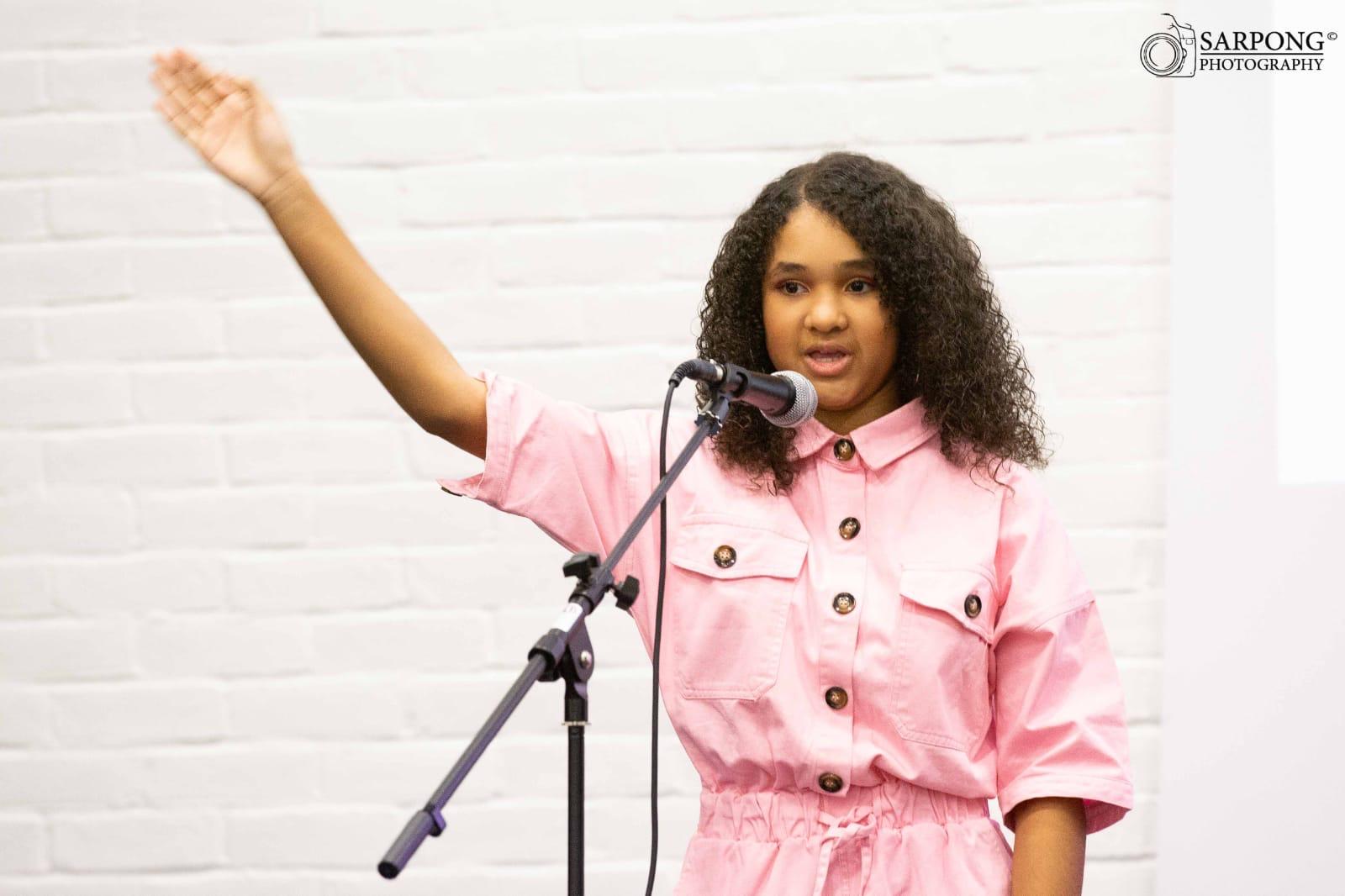 Vanessa speaking on stage